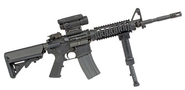 An M4 carbine, showing a pistol grip and a vertical foregrip that converts to a bipod